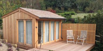Bespoke timber summerhouse clad in Siberian Larch