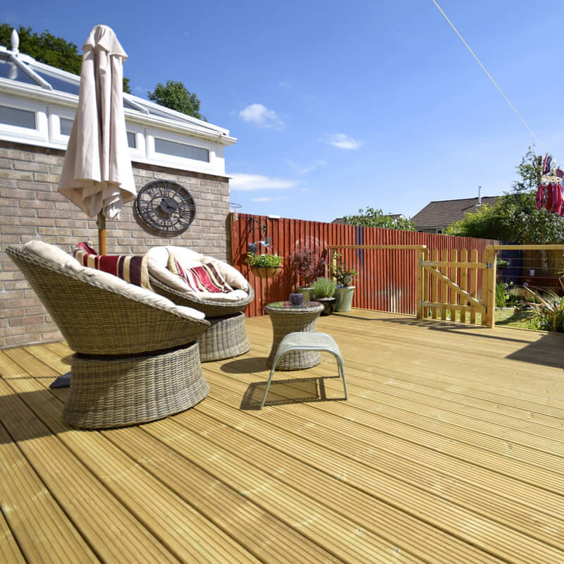 Premier Decking Boards in this lifestyle image of a summer garden