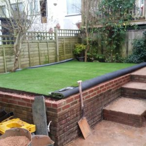 Groundwork done, substrate prepared and Namgrass laid out to rest before fixing