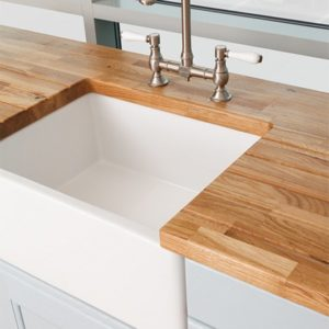 Oak worktop with inset white ceramic sink