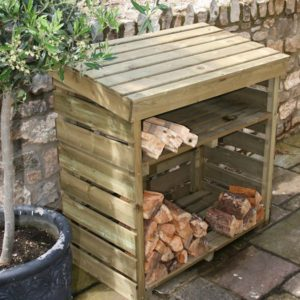 This Hutton Log Store looks at home in this traditional garden
